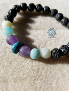 Find clarity and voice your truth with this beautiful handmade mala style bracelet. Strung with matte Amazonite, Amethyst and Turquoise, this one of a kind bracelet supports the opening of the throat chakra. Turquoise is one of the oldest stones used in jewelry - a grounding and calming presence. Alongside amethyst's access to intuitive wisdom and set in a bed of lava stone, the Amazonite will open the Voice and guide your way.