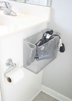 Hide hot tools in a file box on the side of your sink. - good storage idea for the hair dryer in our new apartment