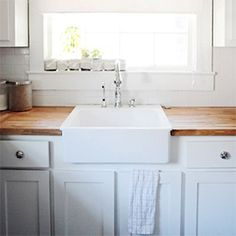 Butcher block counters + white cabinets are such a warm and chic combination for the kitchen! (via Young House Love)