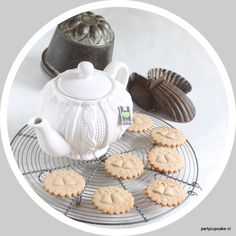 Sugar, cinnamon flavoured, cookies made with a springerle wedding or Christmas bells mould.