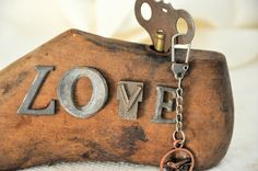 Wood shoe form assemblage with love spelled out using vintage metal letters. $55.00, via Etsy.