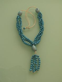 Seeds jewelry: Acai seeds and tinted vegetable ivory necklace. $20,00, via Etsy.