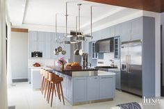 With colorful cabinets and classic flair, this is a dreamy kitchen.