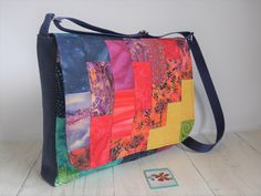 This large messenger style crossbody bag has patchwork sections made from offcuts of batik fabrics in the colours of the rainbow.  A bright addition to your outfit! Rainbow Colours, Belt Bags, Navy Fabric, Crossbody Messenger Bag, Patchwork Bags, Uk Shop, Bag Making, A4, Diaper Bag