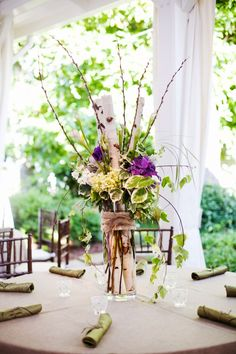 Tall table centerpiece with greenery and birch by the Enchanted Florist, CJ's Off the Square Spring Open House - photographed by Jen and Chris Creed