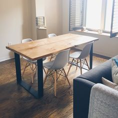 Reclaimed pinewood dining table with 4'' wide handmade wrought iron legs