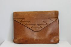 Obsessed with Brown leather envelope clutches