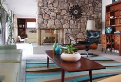 The stacked stone peninsula fireplace separates the living room from the family room. The hearth is original terrazzo from 1963. Repinned by Secret Design Studio, Melbourne. www.secretdesignstudio.com