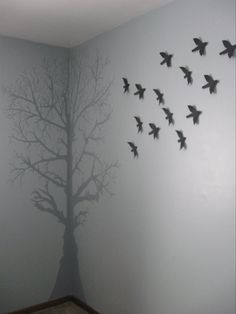 Mural.....hand painted tree wall mural in corner with birds wall hanging (birds from Target)