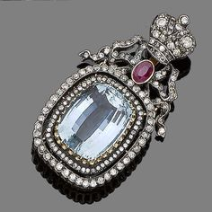 An aquamarine and diamond pendant The fancy-cut aquamarine within a double surround of single-cut diamonds to a brilliant and single-cut diamond bow and coronet surmount centrally-set with an oval-cut ruby