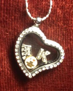 Love my Grandkids Floating charm locket.   Found at www.charmingincentives.com