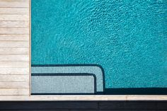 Soft grey tile reflects blue skies in this family pool. The contrasting trim is at once decorative and functional proving effective as a subtle wayfinding solution.