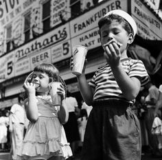 two kids eating hot dogs in front of nathan's, coney island | 1948 | #vintage #1940s #newyork