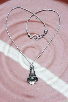 Iron Jewelry: Hand forged Iron and Green Amethyst Calla Lily Pendent on Freshwater Pearls