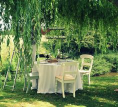 A beautiful garden dining set up. Can you spot our stylist in the trees??  #interiors #photoshoot #photography #location #gardens