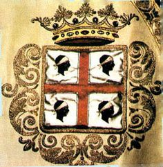 an original Coat of Arms for Sardinia. It is possible that the 4 heads represent the 4 noble Moorish Kings who were killed during battle for the Iberian Peninsula. They were beheaded and brought to Peter of Aragon (still with their royal crowns on their heads).
