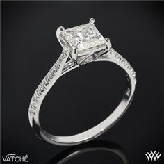 Square single center stone, with dimond band :)