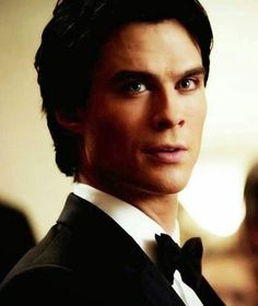 The look Damon gives once he sees Elena coming down the stairs in her blue dress