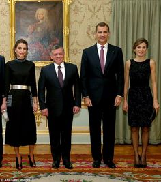 Queen Letizia (right) and Queen Rania (left) transformed into black beauties come nightfall for an official dinner in Madrid. Pictured left centre is Rania's husband, Jordanian King Abdullah II, and right centre, Letizia's husband, King Felipe