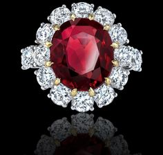 Oval, 7.62 carat ruby, diamond and platinum ring. Royal Cluster Collections Garrard