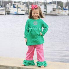 Green polka dot shirt with monogram.