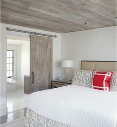 A modern version of the look is seen in this Florida bedroom. Keeping the ceiling, barn door, and bathroom vanity the same material creates flow and serenity, while the rustic wood itself is a cool fe (Cool Bedrooms Rustic)
