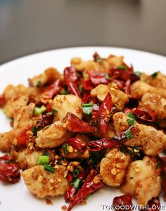 Sichuan Red Chilli Chicken Recipe   It's basically tiny cubes of diced chicken, deep fried and coated with Sichuan pepper, and tossed in a mountain of dried red chillies. Tongue-numbing, fragrant and delicious. http://www.tofoodwithlove.com/2011/05/sichuan-red-chilli-chicken.html