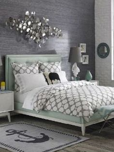 To give a soft-gray interior a feminine edge, Jonathan Adler incorporated rounded accessories and sculptural lighting into this catalog shot.See more amazing bedrooms >