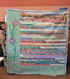 ❤ =^..^= ❤   Linda's Quiltmania: Jelly Roll Race Quilts.  Another way to jazz up a 1600 quilt.