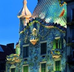 Casa Batllo  This is what my house should look like. Love the roof that looks like a chameleon or sea serpent and walls with no corners.