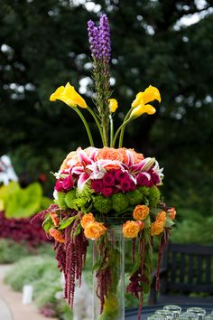 Tall dramatic floral wedding centerpiece - bright color accents