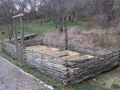 Raised beds enclosed by wattle fence