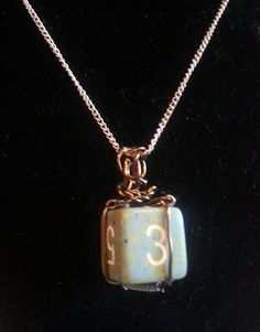 Wire wrapped dungeons and dragons gamer dice pendant necklace available in my Etsy shop https://www.etsy.com/listing/518632958/wire-wrapped-6-sided-dice-pendant