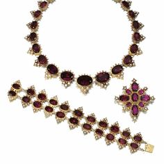 GOLD AND GEM-SET PARURE, CIRCA 1825 Comprising: a necklace, brooch and bracelet set with foil backed faceted amethyst, pearls and gold bead work, and three later drops set with pear-shaped amethyst, two mounted as earrings and one as drop on brooch, necklace length approximately 410mm, bracelet length approximately 176mm, earrings with hook fittings, later alterations, fitted cases, Hunt & Roskell, part illustrated.