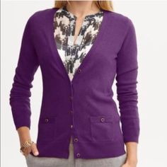 Banana Republic Button Cardigan Banana Republic v-neck cardigan with grosgrain buttons in a deep purple. Long sleeves. Fabric covered buttons edged in gold. Front pockets at hip. Size small, excellent condition. Banana Republic Sweaters Cardigans
