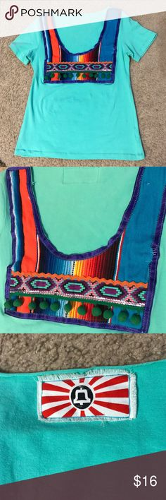 Mexican Style Boutique Top This is a vibrant, great for summer Mexican style Boutique top! A few pulls in the fabric as pictured but still totally cute! The shirt color is teal and should fit between a size small or medium. Tops Tees - Short Sleeve