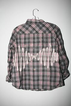 """Arctic Monkey's bleached plaid shirt inspired by their album """"AM"""" and the 90s grunge aesthetic. This flannel shirt has been upcycled and hand bleached with bleach splatters across the front and back. This piece is ONE OF A KIND. Product is unisex.  Measurements: One size Chest: 18"""" Shoulder: ..."""