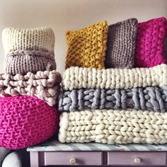 So much chunky knit in one place, some of the orders for this week, a fabulous pink footstool pouffe, mustard yellow cushions and huge chunky blankets in grey and white as well as a new scarf design I'm working on! It was very cosy here!