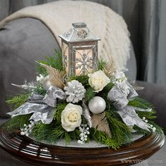 Silver Lantern #39814 by Viviano Flower Shop | Lanterns have beautiful meanings of love, illumination, haven, and hope, a beautiful way to welcome guests to your holiday home for Christmas and New Year's Eve! Beautiful color scheme of sparkling silver and white with touches of gold.