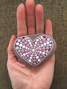 I sell this beautiful hand-painted mandala stone in the colours powder, pink, mallow, hellrose, silver and white. The natural stone from the Danish North Sea coast was painted by hand with acrylic paint in point technique and then sealed with acrylic clear coat. The stone is intended for