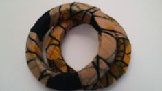 Check out this item in my Etsy shop https://www.etsy.com/listing/216487624/brown-black-ankara-bracelet