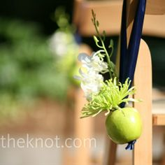 """apple wedding decor for the chapel pews! Make the apples gold/red and use wheat to make it more """"fall"""" than """"spring"""""""