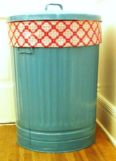 HAMPER- How adorable!  Trash can sold at Home Depot  Use Krylon spray paint.  From homedepot.com: When working with metal Remove loose rust with a wire brush, sandpaper or chemical rust remover. Remove oil with a degreaser or denatured alcohol especially on new metal. Prime surface to protect against rust and corrosion. Lightly sand glossy surface if previously painted and remove dust with a tack cloth. Outdoor metal should always be primed before painting for greatest durability.