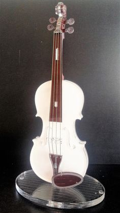 Violin model, Music art, Best selling item, Teacher gift, Musician gift, Home decor, Music gift, 3d art.  This beautiful elegant white and brown transparent violin model is medium sized, and made of laser-cut acrylic glass.  It consists of 26 parts, including realistic strings and an elegant stand, which are interconnected with patented designed pins, no glue was used. All parts are hand-assembled.The materials characteristics allow for a beautiful durable crystalline sheen.  This elegantly…