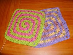 Two colors chase each other out from the center of this square crocheted dishcloth.