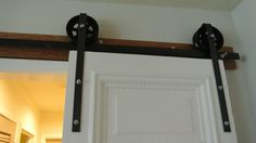 Items similar to Handcrafted Iron Barn Door Rollers on Etsy Barn Door Rollers, Handmade Art, Home Accents, Iron, Doors, Kitchen, Etsy, Home Decor, Cooking