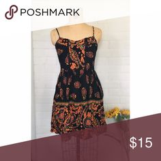 Band of gypsies' sundress This sundress is great for summer all the way going into fall with its rich colors! The brand Band Of Gypsies creates great quality pieces that will last. This dress is labeled a size large but fits like a Medium with a stretchy back to fit a Large also. Band of Gypsies Dresses Mini