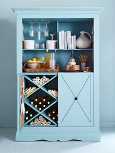 DIY Bar Cabinet  A fantastic idea, especially for those who are tight on space. Transform an armorie into an open bar cabinet, equipped with everything you need to serve and store liquor and wine (via BHG). I'd add a patterned wallpaper or mirrored panels to the back of the cabinet for a special touch!