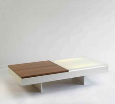 coffee table. Joseph-Andre Motte. 1958. rosewood, glass = white lacquered metal