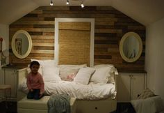 pallets deconstructed and used on accent wall. cheap and awesome = <3